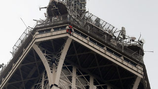 Eiffel Tower evacuated as man scales monument