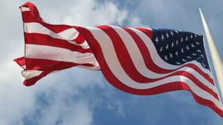 Massive American flag at RV dealership leads to fines, legal action