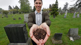 FILE - In this April 19, 2019, file photo, Katrina Spade, the founder and CEO of Recompose, a company that hopes to use composting as an alternative to burying or cremating human remains, poses for a photo in a cemetery in Seattle.