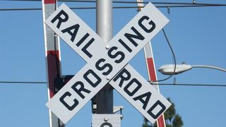 Deputy struck by train while driving through railroad crossing on way to emergency call
