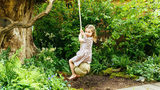 Britain's Princess Charlotte, daughter of Prince William and Kate, Duchess of Cambridge plays in the Adam White and Andree Davies co-designed garden ahead of the RHS Chelsea Flower Show in London.