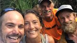 Amanda Eller smiles with Javier Cantellops, left, Troy Helmer and Chris Berquist after she was found after going missing for more than two weeks in a Hawaii reserve.