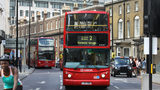 A lesbian couple in London said they were attacked on a bus after refusing to kiss for a group of men.