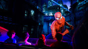 A child with autism had a meltdown when The Amazing Adventures of Spider-Man ride broke down. Instead of making the child leave, a worker got down on his level to comfort him. Their story has since gone viral.