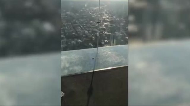 Glass Skydeck cracks under visitor's feet 103 stories high