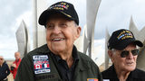 US WWII veterans KT Robbins (L), 97, from Olive Branch, Mississippi, and Buck Price from Tarboro, North Carolina, stand on Omaha Beach (Photo by Fred TANNEAU / AFP)
