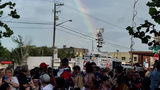 Under the glow of a rainbow, 1,500 people gathered outside Orlando's Pulse nightclub for a public remembrance ceremony.
