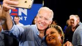 Democratic presidential candidate former Vice President Joe Biden poses for a photo with an audience member after speaking at Clinton Community College, Wednesday, June 12, 2019, in Clinton, Iowa.