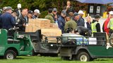 The golf cart that injured five people Friday is inspected by spectators during Friday's second round of the U.S. Open.