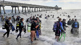 Divers enter the water in an attempt to break the world record for the largest underwater cleanup at the Deerfield Beach International Fishing Pier in Deerfield Beach, Fla., Saturday, June 15, 2019.