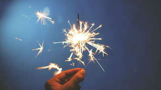 Family taking photo with sparklers causes fast-moving fire, officials say
