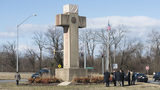 In this Feb. 13, 2019 file photo, visitors walk around the 40-foot Maryland Peace Cross dedicated to World War I soldiers in Bladensburg, Maryland.