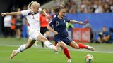 Norway's Maria Thorisdottir, left, vies for the ball with France's Gaetane Thiney during the Women's World Cup Group A soccer match between France and Norway in Nice, France, Wednesday, June 12, 2019. (AP Photo/Claude Paris)