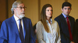Michelle Troconis, center, listens, as her attorney, Andrew Bowman, left, addresses the court during a court hearing Tuesday, June 11, 2019, in Stamford, Conn. (Erik Trautmann/Hearst Connecticut Media via AP)