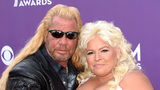 TV personalities Dog the Bounty Hunter (L) and Beth Chapman pictured in 2013. Beth Chapman died of Stage II throat cancer in 2019