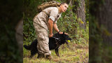 Lance Cpl. Jacob Varela, a combat tracker with Military Working Dog Platoon, 2nd Law Enforcement Battalion, II Marine Expeditionary Force Headquarters Group, pets his dog Atilla. (U.S. Marine Corps photo by Lance Cpl. Lucas J. Hopkins/Released)