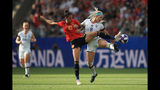 REIMS, FRANCE - Jennifer Hermoso of Spain and Julie Ertz April of USA go for a ball during the 2019 FIFA Women's World Cup Round Of 16 match. Photo by Marc Atkins/Getty Images