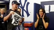 Meghan Markle, the Duchess of Sussex, applauds as the New York Yankees present a jersey for baby Archie before the team met the Boston Red Sox in London on Saturday.