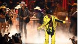 """Lil Nas X, right, appeared on stage with Billy Ray Cyrus to perform """"Old Town Road"""" at the BET Awards show on June 23 in Los Angeles."""