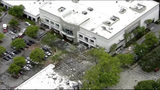 This image taken from video provided by WPLG shows debris covering the parking lot of a shopping center after an explosion on Saturday, July 6, 2019 in Plantation, Fla.