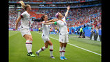 Megan Rapinoe of the USA celebrates with teammates Alex Morgan and Samantha Mewis after scoring her team's first goal during the 2019 FIFA Women's World Cup France Final match between The United States of America and The Netherlands.