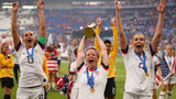 Megan Rapinoe of the USA celebrates with the FIFA Women's World Cup Trophy following her team's victory in the 2019 FIFA Women's World Cup France Final match between The United States of America and The Netherlands.