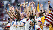 The U.S. women's soccer team celebrating their World Cup victory as Megan Rapinoe lifts the World Cup Trophy following the team's victory in the World Cup final between the U.S. and the Netherlands at Stade de Lyon on July 07, 2019 in Lyon, France.