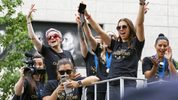 Members of the U.S. women's soccer team, including Megan Rapinoe, rear left, and Alex Morgan, right foreground, enjoy the moment during Wednesday's ticker-tape parade in New York's