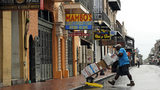 Fred Foster makes a delivery on Bourbon Street in the French Quarter Saturday in New Orleans, as Tropical Storm Barry nears landfall. (AP Photo/David J. Phillip)