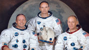 This March 30, 1969, photo made available by NASA shows the crew of the Apollo 11, from left, Neil Armstrong, commander; Michael Collins, module pilot; Edwin E.