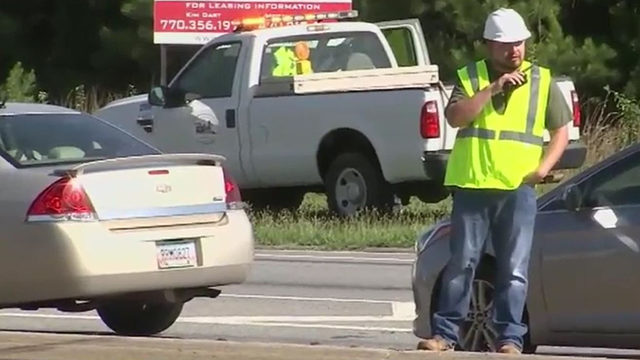 Police pose as construction workers to catch distracted