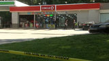 A man was found dead in his car outside this Lithonia, Georgia, gas station, according to police.