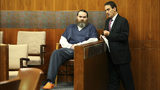 Shaun Gallon, seated, speaks to his attorney Monday, July 15, 2019, in a Sonoma County courtroom prior to his sentencing in the August 2004 murders of Jason Allen and Lindsay Cutshall. The couple was slain as they slept on a California beach.