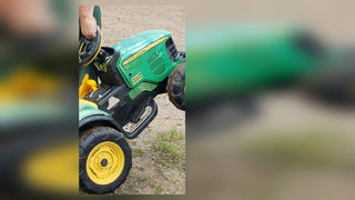 2-year-old takes off in toy tractor, drives to Tilt-a-Whirl at county fair