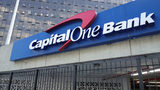 A Capital One bank sign in New York. The Virginia-based bank just announced a massive data breach affecting about 100 million Americans and six million Canadians. A suspect has been arrested.