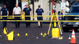 Evidence markers rest on the street at the scene of a mass shooting Sunday, Aug. 4, 2019, in Dayton, Ohio. Several people in Ohio were killed in the second mass shooting in the U.S. in less than 24 hours.