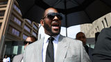 FILE - In this Thursday, June 6, 2019, file photo, musician R. Kelly leaves the Leighton Criminal Court building, in Chicago.