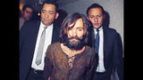 Charles Manson is escorted to his arraignment in 1969 on murder and conspiracy charges in connection with the Tate-LaBianca murder cases in Los Angeles.