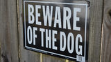"""Stock photo of a """"Beware of the Dog"""" sign."""