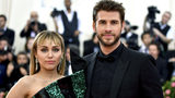 """In this May 6, 2019 file photo, Miley Cyrus, left, and Liam Hemsworth attend The Metropolitan Museum of Art's Costume Institute benefit gala celebrating the opening of the """"Camp: Notes on Fashion"""" exhibition in New York."""