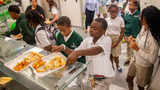 Students at Drew Charter School pick up their school lunch Friday, Aug. 9, 2019.