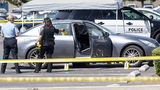 Police investigate a car where a retired Cal State Fullerton administrator was stabbed to death Monday, Aug. 19, 2019, in Fullerton, Calif.