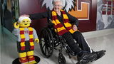 Sister Jean Dolores Schmidt, who turned 100 Wednesday, poses with her Lego look-alike Tuesday.