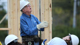 Former President Jimmy Carter helps position an exterior wall while working on a Habitat for Humanity build November 2015 in Memphis. Carter will return to building Habitat houses in October 2019.