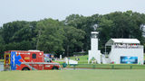 An ambulance arrives to provide medical assistance after a lightning strike during a suspension of the third round Saturday due to inclement weather of the Tour Championship at East Lake Golf Club.
