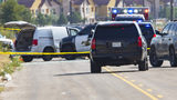 """Odessa and Midland police and sheriff's deputies surround a white van in Odessa, Texas, Saturday, Aug. 31, 2019, after reports of gunfire. Police said there are """"multiple gunshot victims"""" after reports of gunfire on Saturday in the area."""
