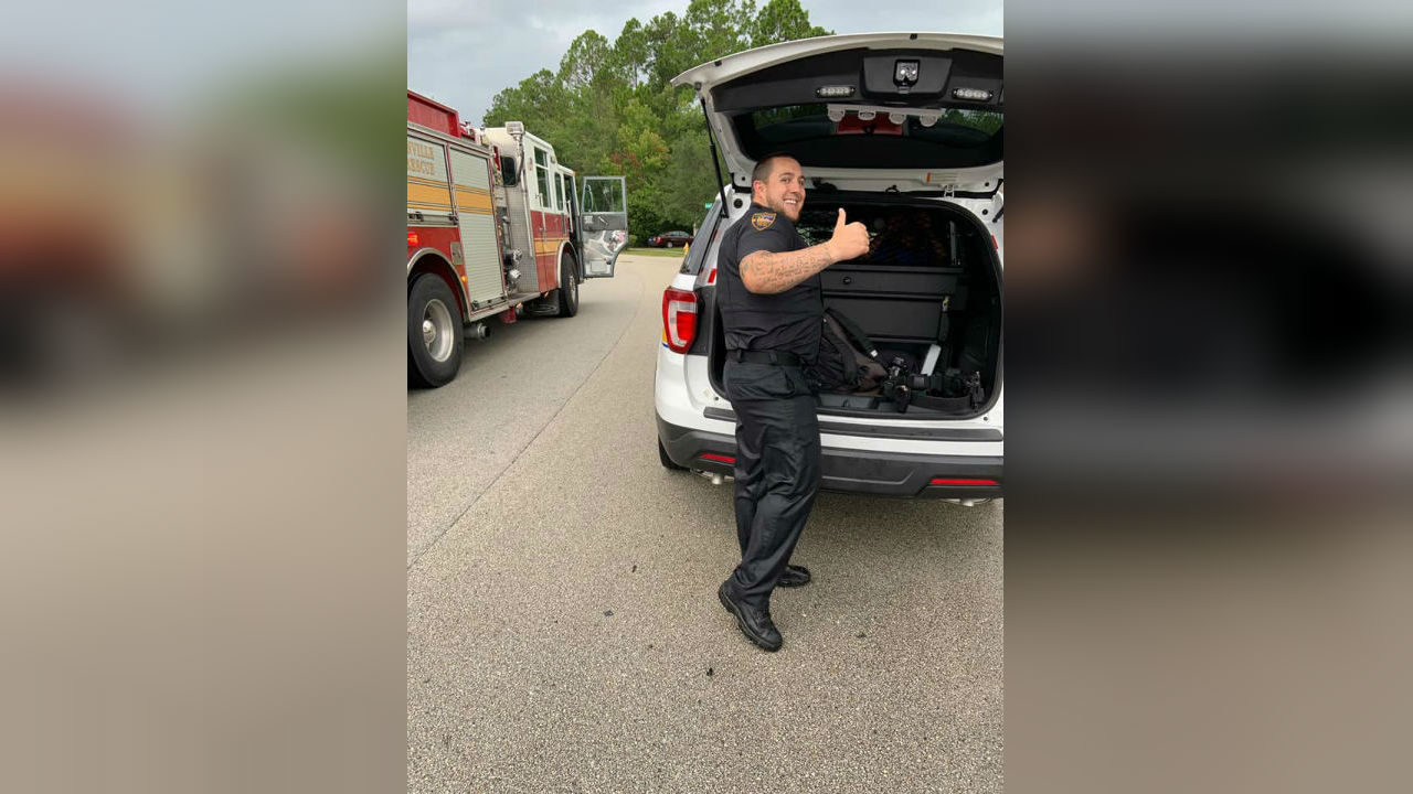 Officer jumps into pond in full gear to save nonverbal child