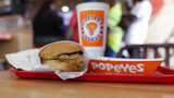 A group of people armed with a gun tried to enter a Houston Popeyes restaurant and demand chicken sandwiches, police said.