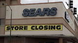 Nearly a year after declaring bankruptcy, retail giant Sears has laid off 250 employees from its headquarters and may close more Sears and Kmart stores by the end of the year.