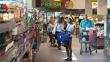Customers shop at an Aldi grocery store on June 12, 2017, in Chicago.